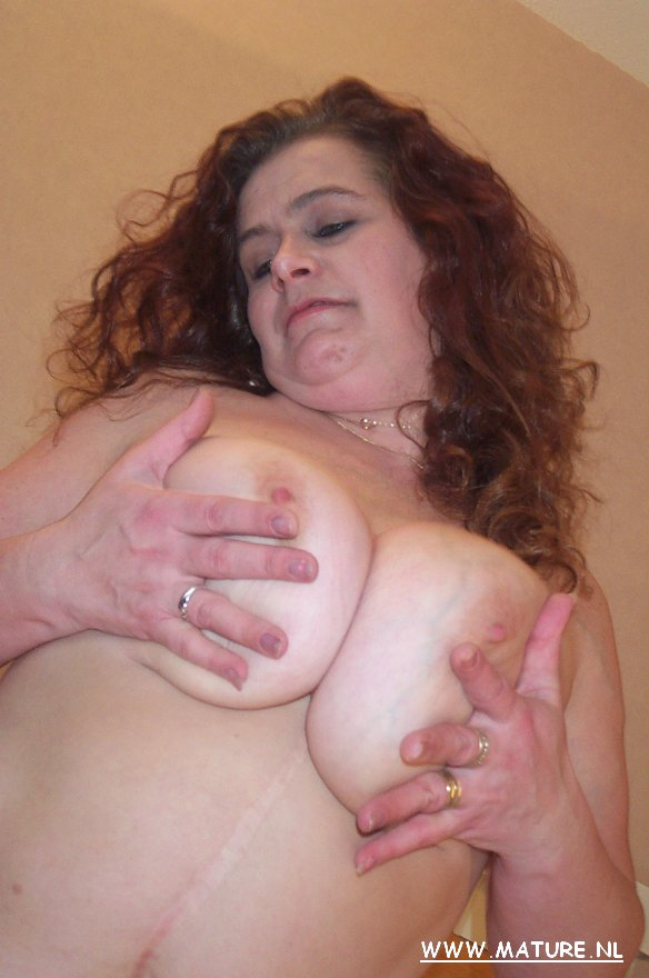 Ample boobed mature superslut displaying off what she's got