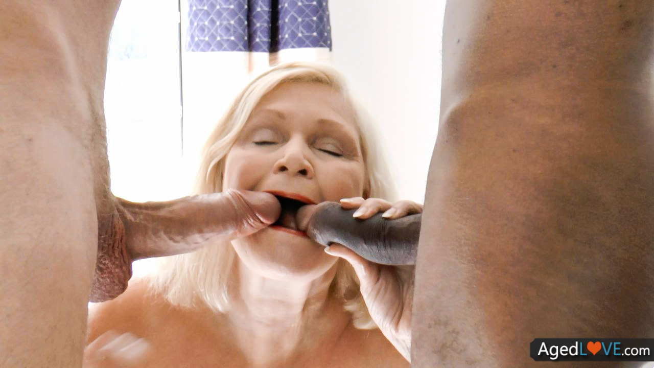 Well aged blond BBW treating 2 shafts