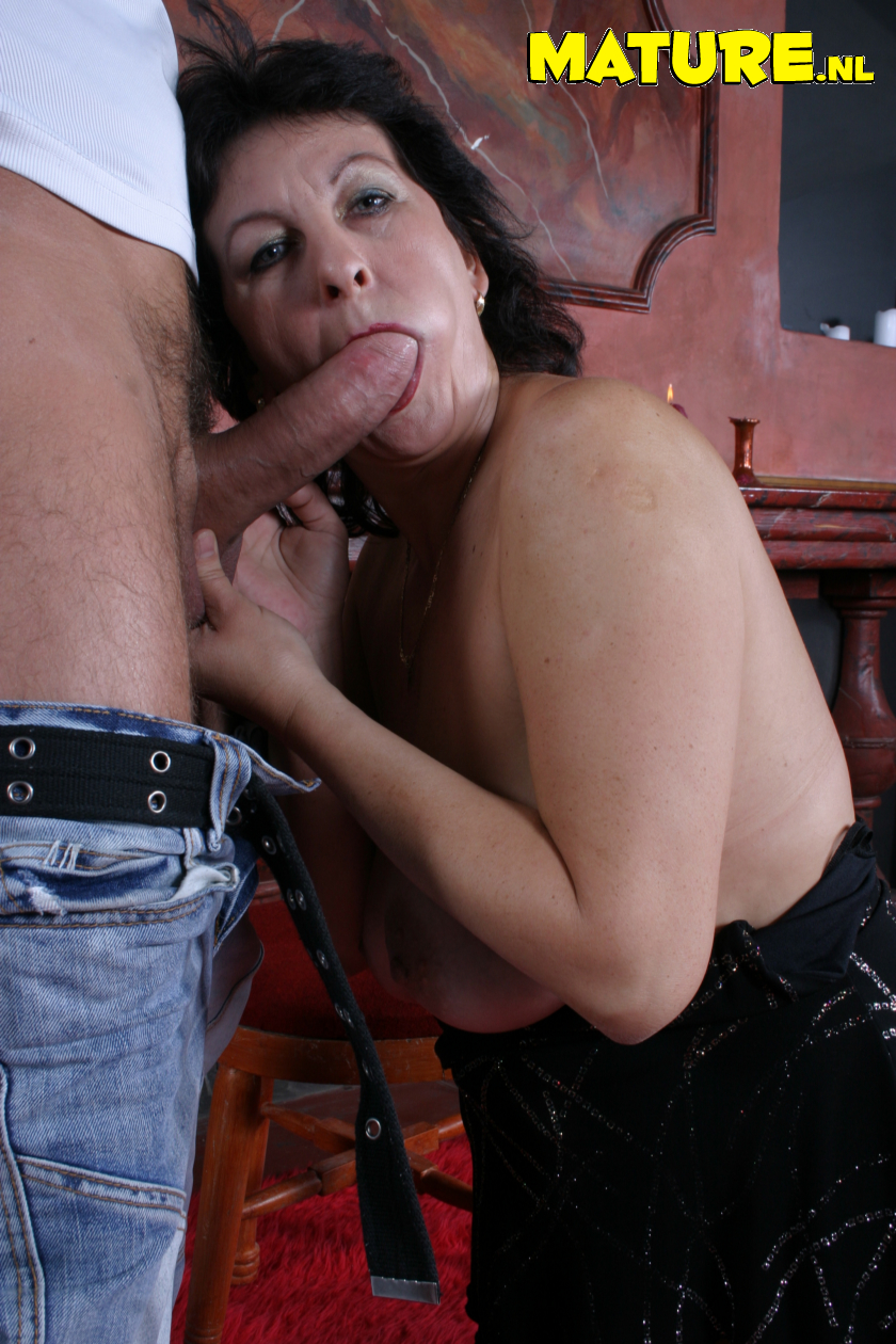 Insatiable mature tramp in fellating and boning act