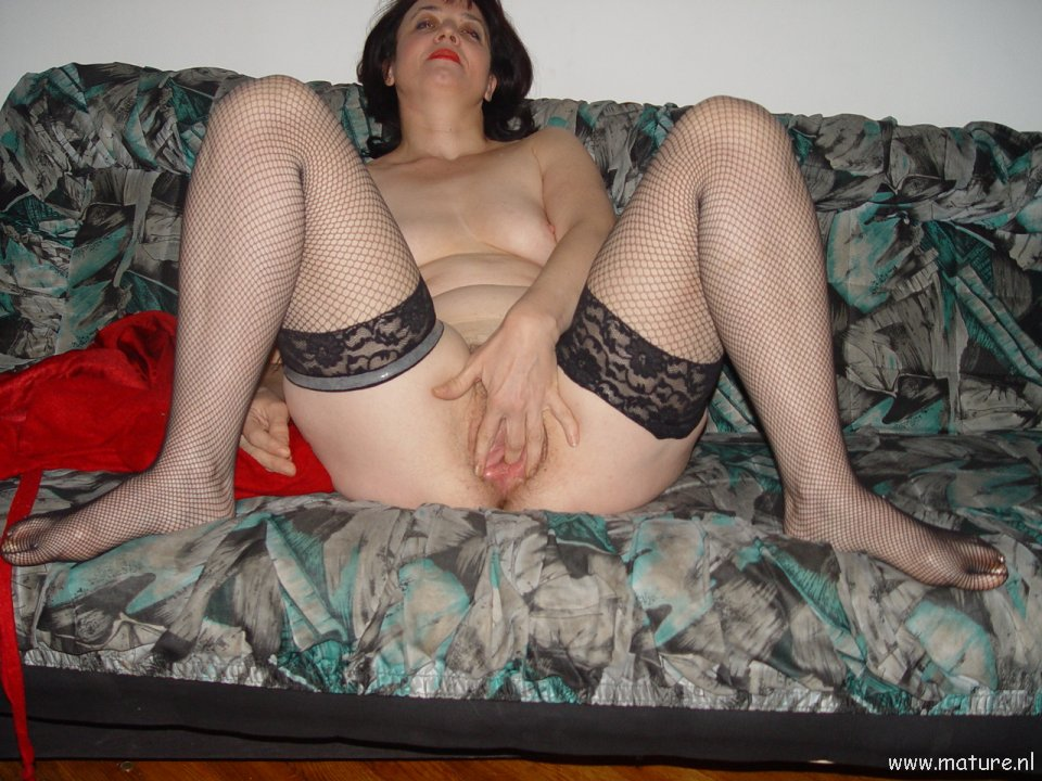 Nasty aged female flashing her raw slit
